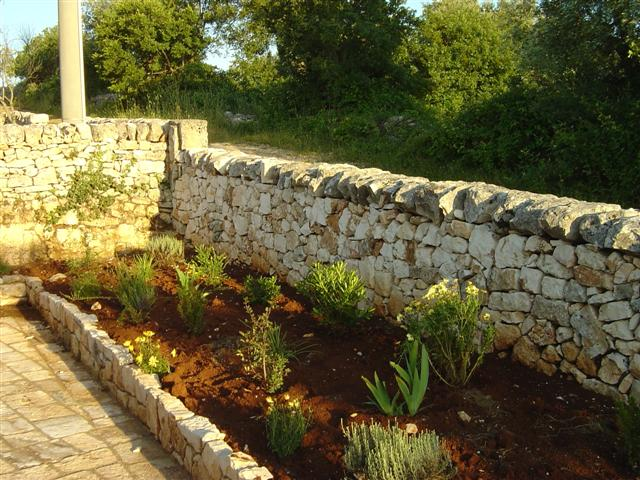 Hardscaping with a retaining wall and walkway